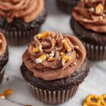 Chocolate Cupcakes with Peanut Butter Filling, Whipped Chocolate Ganache, and Crushed Pretzel